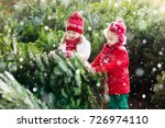 family selecting christmas tree.... | Shutterstock . vector #726974110