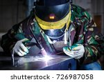 professional welder working... | Shutterstock . vector #726987058