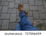 leather boots and jeans against ... | Shutterstock . vector #727006459