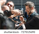 Small photo of Andy Serkis on the autograph session during the 2017 Toronto International Film Festival - September 12, 2017 in Toronto, Canada