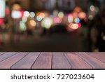 wooden table over blurred... | Shutterstock . vector #727023604