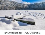 Boat With Snow At The Frozen...
