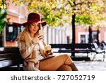 young woman using smartphone in ... | Shutterstock . vector #727052719