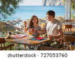 young couple in beach cafe fun... | Shutterstock . vector #727053760