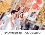 romantic couple having fun... | Shutterstock . vector #727066090