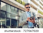 mature businessman standing and ... | Shutterstock . vector #727067020
