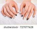 manicured hands on white towel. ... | Shutterstock . vector #727077628