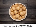 raw potato and basket on wooden ... | Shutterstock . vector #727097044