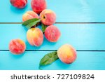 ripe peaches with leaves on... | Shutterstock . vector #727109824