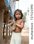 Small photo of Boca de valeria, Brazil - December 03, 2015: girl child selling sloth in village. Earning money and lifestyle concept. Poverty and childhood