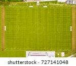 Small photo of Aerial view of football field. New public soccer stadium outdoors from above. Beautiful soccer playground as background texture concept.