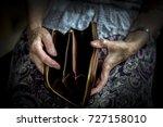 an elderly man holding an old... | Shutterstock . vector #727158010