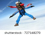 Small photo of Tandem skydiving. The tandem is in the amazing sky.