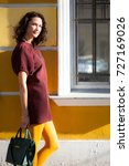 beautiful woman with a burgundy ... | Shutterstock . vector #727169026