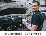 handsome mechanic in uniform is ... | Shutterstock . vector #727174663