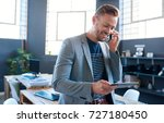 smiling young businessman... | Shutterstock . vector #727180450