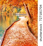 Small photo of Conceptual scenery - Road inside Autumn. Amazing seasonal autumnal landscape of promenade path along Bled lake bank in Slovenia. Bled is famous and popular travel destination for romantic couples.
