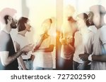 blurred businessmen that work... | Shutterstock . vector #727202590