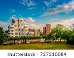 looking at media harbor at... | Shutterstock . vector #727210084
