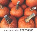 fall pumpkins background | Shutterstock . vector #727238608