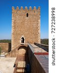 Small photo of Keep tower of Mertola Castle with the adjoining fortress wall with battlements. Mertola. Portugal