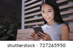 woman using mobile phone in... | Shutterstock . vector #727265950