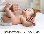 mother or doctor cleans baby's... | Shutterstock . vector #727278136