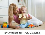 cute mother and kid boy play... | Shutterstock . vector #727282366