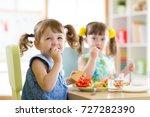 cute little children eating... | Shutterstock . vector #727282390