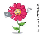 with laptop pink flower... | Shutterstock .eps vector #727289698