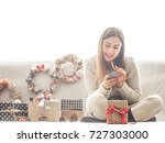 beautiful girl with christmas... | Shutterstock . vector #727303000