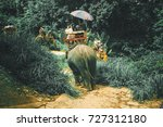 tourists riding elephants... | Shutterstock . vector #727312180