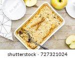 apple crumble in baking pan... | Shutterstock . vector #727321024