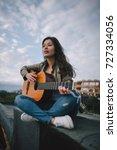 Free Music. Female Guitarist...