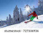skier skiing downhill in high... | Shutterstock . vector #727336936