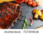 fried potatoes and pork ribs on ... | Shutterstock . vector #727354018
