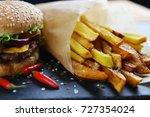 tasty and appetizing hamburger... | Shutterstock . vector #727354024