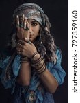 Gypsy style young woman wearing ...