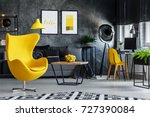 designer's yellow chair next to ... | Shutterstock . vector #727390084
