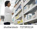 female chemist arranging stock... | Shutterstock . vector #727393114