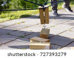 wooden blocks being lifted by... | Shutterstock . vector #727393279