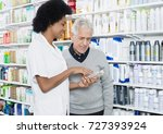 pharmacist showing information... | Shutterstock . vector #727393924