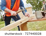 craftsman working with hammer... | Shutterstock . vector #727440028
