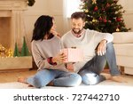 pleasant couple sitting on... | Shutterstock . vector #727442710