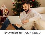 pleasant man working on laptop... | Shutterstock . vector #727443010
