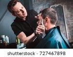 handsome bearded man having his ... | Shutterstock . vector #727467898