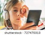 tired little girl with... | Shutterstock . vector #727470313