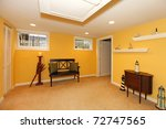 Yellow basement room design with black bench - stock photo