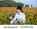pretty young agronomist holding ... | Shutterstock . vector #727493764