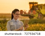 pretty young woman with tablet...   Shutterstock . vector #727536718